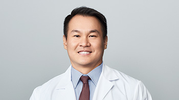 Close up of Mary Kay scientist David Gan on a gray background.
