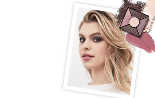 Get the steps to achieving the hottest looks of the season using the new color collection from Mary Kay. In the right corner, a white photo frame shows a young woman wearing a purple smoky eye and a pink lip. Above the upper right corner is the new Limited-Edition Eye Palette in Rose Nudes.